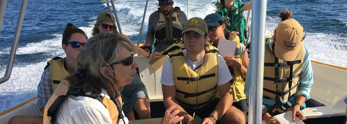 Students at Kino Bay Center take notes while on a boat ride
